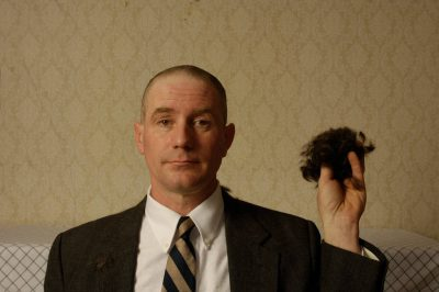 Photo: A man has mixed emotions about having his head shaved.