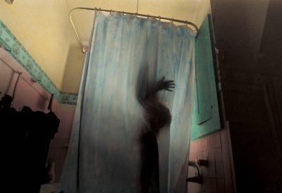 Photo: A pregnant Kathy Sartore showers in her home near Walton, Nebraska.