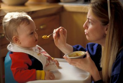 Photo: Kathy Sartore feeds her young son, Cole at their home near Walton, NE.