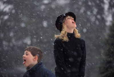 Photo: Kathy Sartore catches snowflakes with her son, Cole.