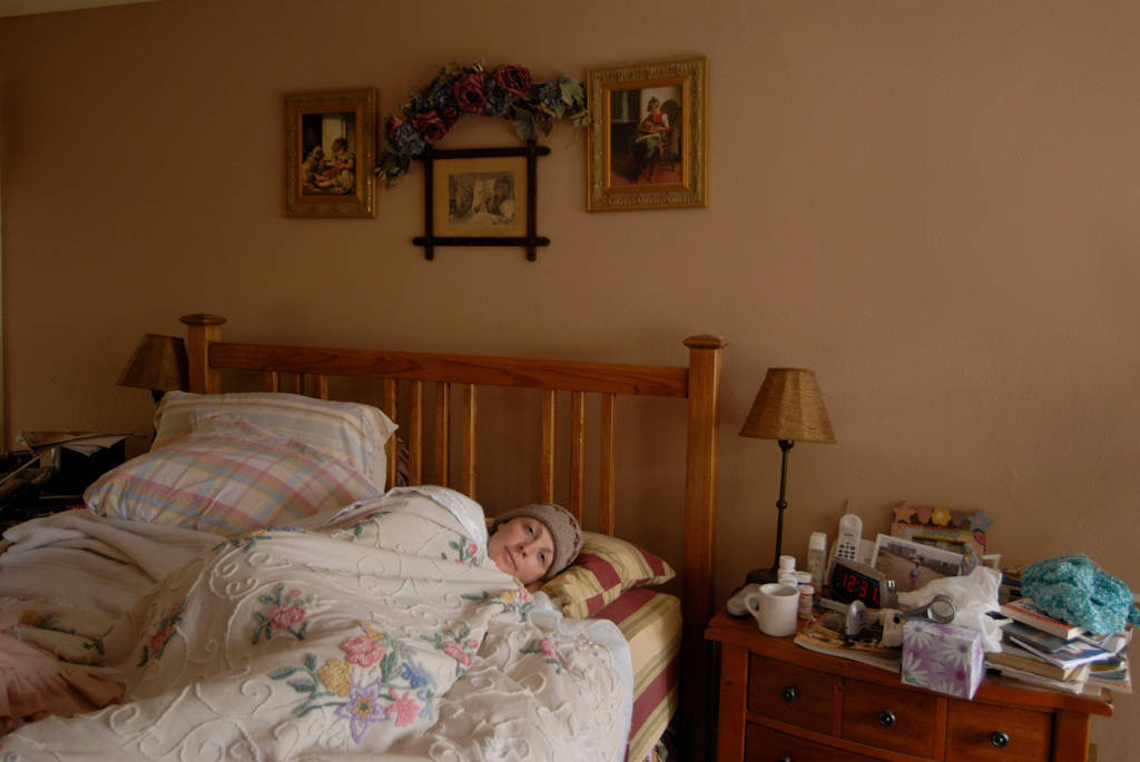 Photo: Kathy Sartore, sick from chemotherapy for breast cancer, retreats into her room.