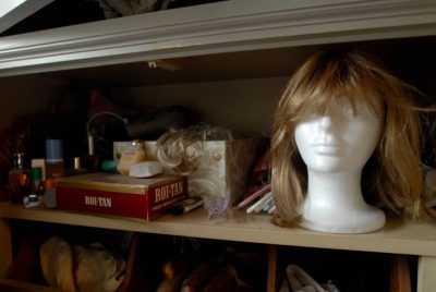 Photo: Kathy Sartore wears a wig (shown on a mannequin head here) to cover up hair loss from chemotherapy for breast cancer.