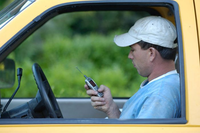 Photo: Kenton Rowe uses his cellular phone in his truck in Lincoln, NE.