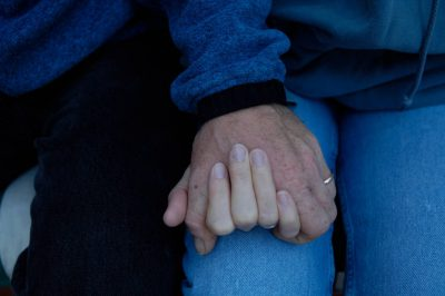 Photo: Joel and Kathy Sartore holds hands at their home in Lincoln, NE.