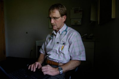 Photo: A doctor sits in his office.