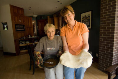 Photo: A mother and daughter show what they are baking.