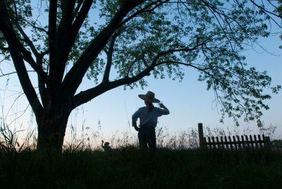 Photo: Two children in cowboy hats wave to each other on a farm near Princeton, Nebraska.