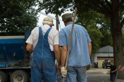 Photo: Two men pour concrete at a Lincoln, Nebraska home.