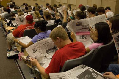 Photo: Students at North Carolina State University read the newspaper as part of a class assignment.