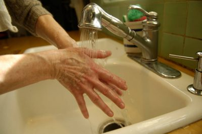 Photo: A Nebraska woman washes her hands.