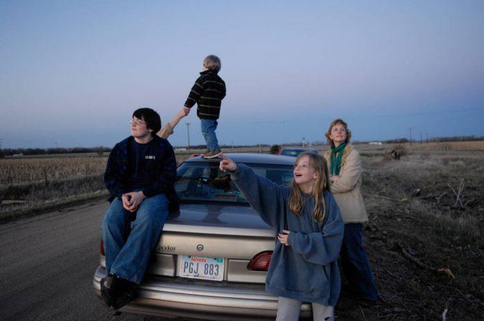 Photo: A family watches sandhill cranes near Gibbon, NE., along the Platte River.