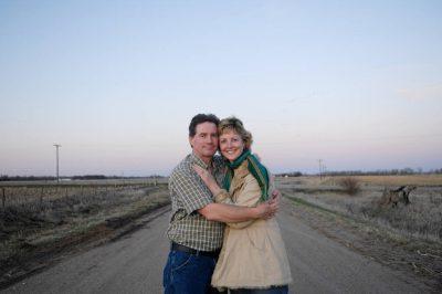 Photo: A man hugs his wife near Gibbon, Nebraska.