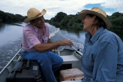Photo: A man and woman go flyfishing out in the vacente, or flooded cow pasture in Brazil's Pantanal.
