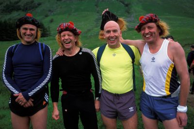Photo: Members of the Wiltshire Fire Brigade laugh and smile while wearing Scottish hats and red wigs on Ben Nevis.