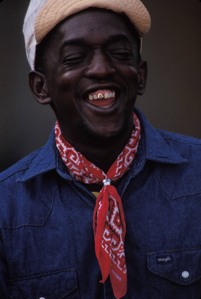 Photo: A boilermaker smiles showing his gold, star shaped tooth while working at the port of New Orleans.