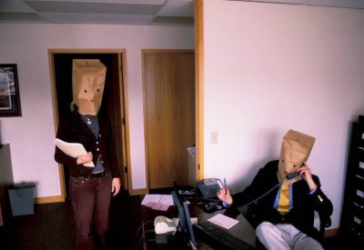 Photo: Office workers find anonymity inside a paper bag in Lincoln, Nebraska.