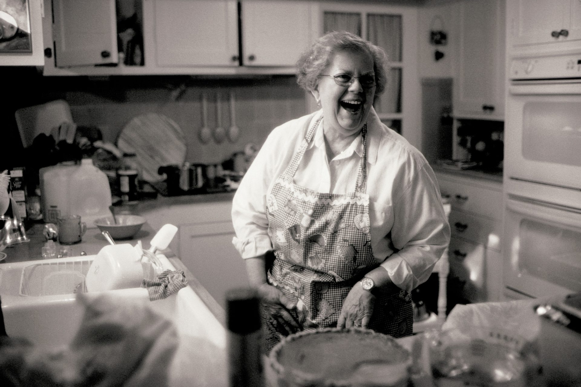 Photo: A woman works in a kitchen after a holiday meal in Lincoln, Nebraska.