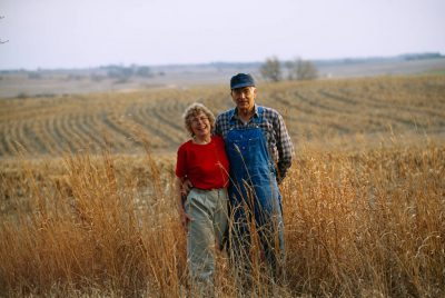 Photo: A farm couple stands for a portrait on their land outside of Cortland, Nebraska.