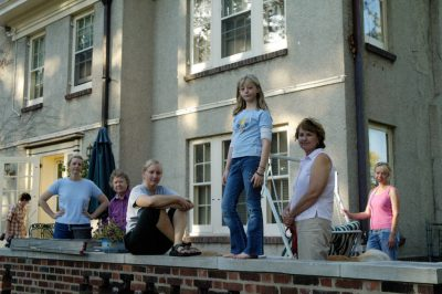 Photo: Three generations of females stand on a backporch in Lincoln, Nebraska.