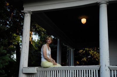 Photo: A woman sits gracefully on a wrap-around porch in Lincoln, Nebraska.