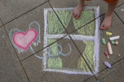 Photo: Art drawn on the sidewalk using colorful chalk.