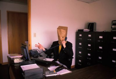 Photo: An office worker finds anonymity inside a paper bag in Lincoln, Nebraska.