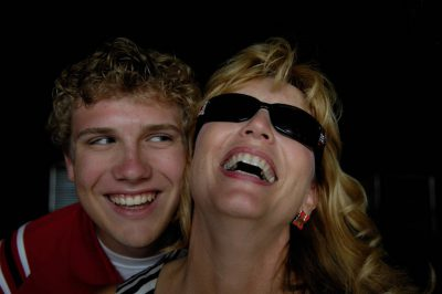 Photo: A woman in sunglasses and her son share a laugh.