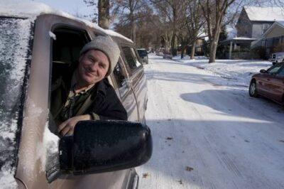 Photo: Joel Sartore hunts for good stuff along the curb.