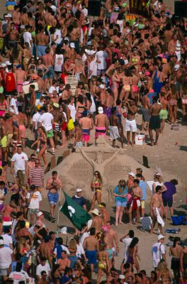Photo: A crucifix sculpture by artists of the Baptist center stands amid students and sunbathers on South Padre Island, Texas.