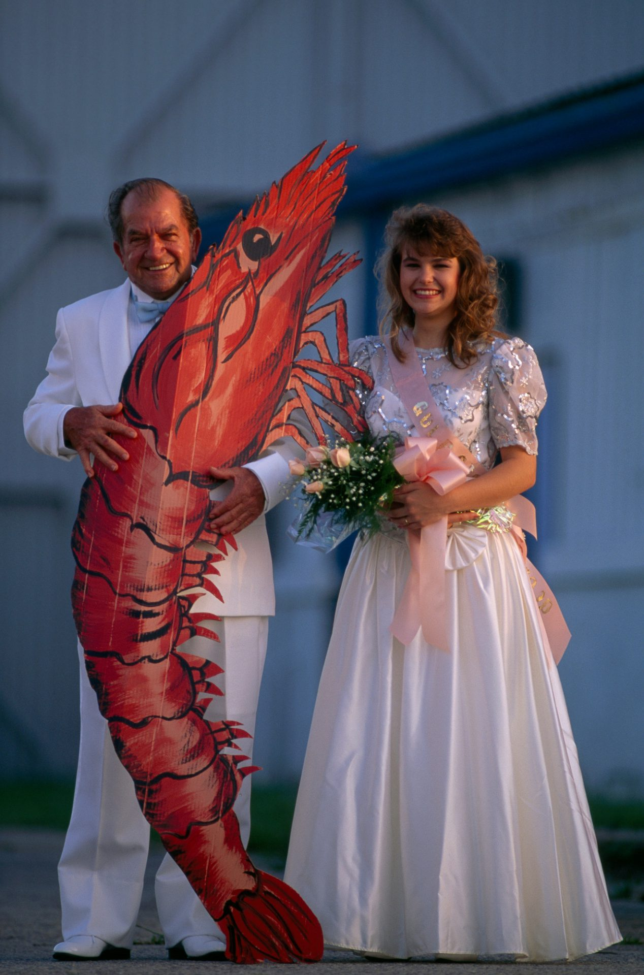 Photo: The king and queen of the Shrimp festival in Biloxi, Mississippi, pose with a cardboard shrimp while presiding over a Cajun-style fais-dodo, or country dance.