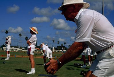 Photo: Retirees bowl at a lawn bowling club in Florida's Sun City center, a retirement community for wealthy patrons.