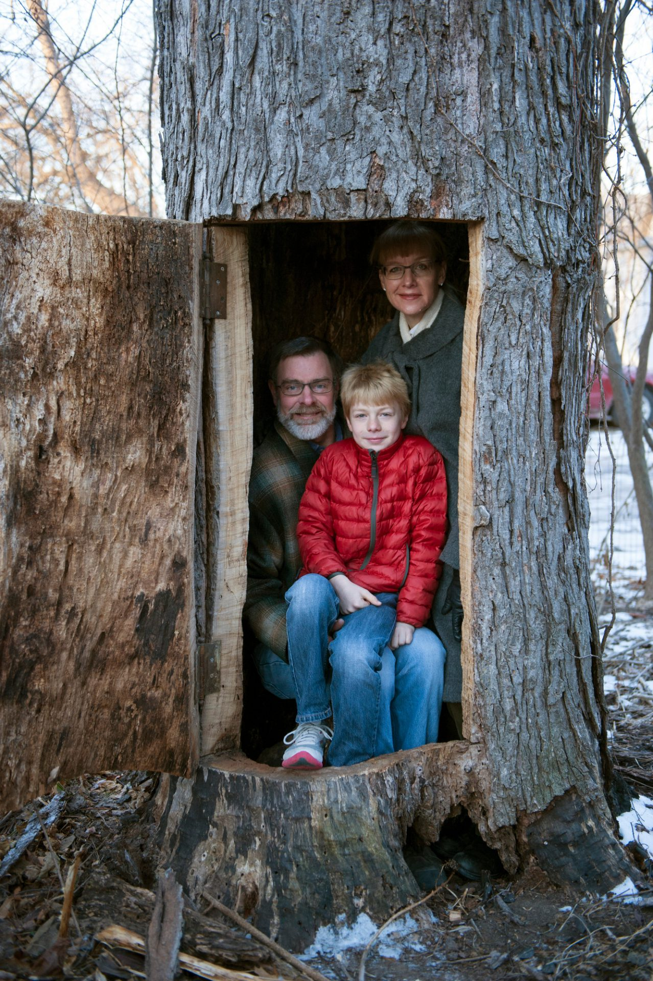 Photo: A family sits inside of a hollowed out tree in Lincoln, Nebraska.