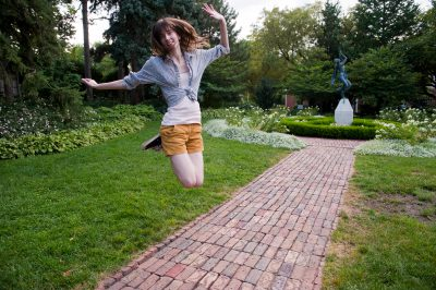 Photo: A teenager jumps in excitement at the Sunken Gardens in Lincoln, NE.