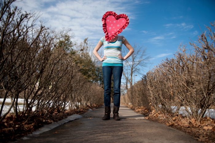 Photo: A young woman wears a heart mask on Valentine's Day.