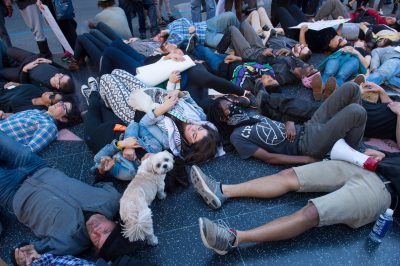 Photo: A men and women lay on the sidewalk as a protest against police brutality in Hollywood, California.