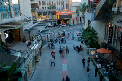 Photo: Pedestrians on the sidewalk in front of storefronts in Hollywood.