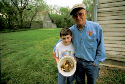 Photo: A boy with his grandfather after a successful day of hunting for morel mushrooms in Nebraska.