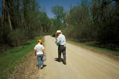Photo: A boy and his grandfather after a successful day of hunting for morel mushrooms in Nebraska.