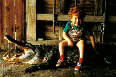 Photo: Five year-old Jonathan Cunningham sits on an alligator (recently hunted by his father) in Morgan City, Louisiana.