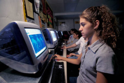 Photo: A student works in a computer lab at a McCool Junction public school.