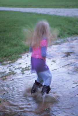 Photo: Ellen Sartore jumps in a puddle.