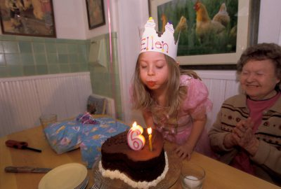 Photo: Ellen Sartore blows out her candles at a birthday party.