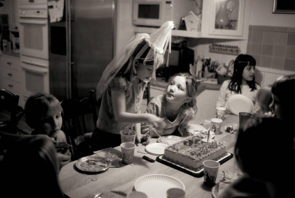 Photo: Ellen Sartore digs into her birthday cake.