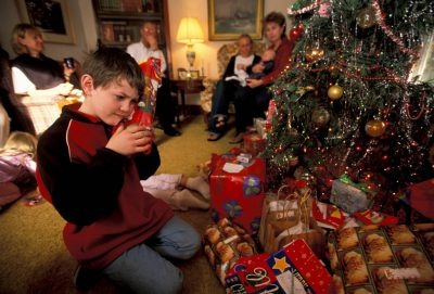 Photo: The Sartore cousins open up gifts on Christmas.