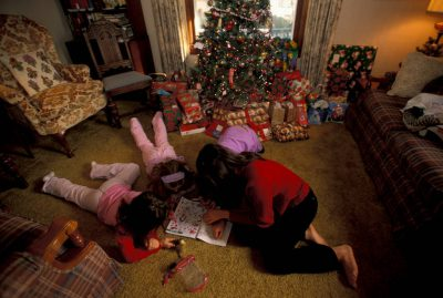 Photo: The Sartore cousins play with gifts on Christmas.