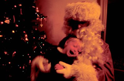 Photo: A boy's early, alarming encounter with Santa Claus (actually his mother in costume.)