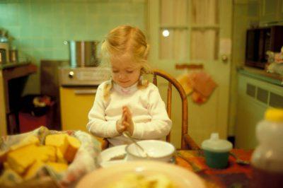 Photo: Ellen Sartore says grace.