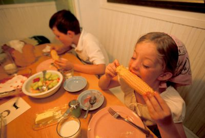 Photo: Cole and Ellen Sartore eating corn on the cob.