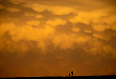 Photo: Cole and Kathy Sartore watch a hail storm roll in from Holmes Lake Dam.