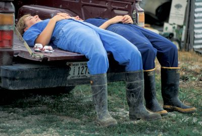 Photo: The Montgomery girls and their mother rest in the bed of a pickup after doing chores at the family's hog farm.